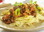 Farfalle with minced meat sauce and aromatic herbs