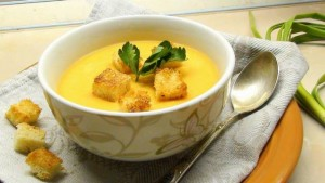 Potato cream soup with fried bread and garlic