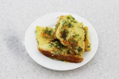 Fried bread with egg, cheese and dill